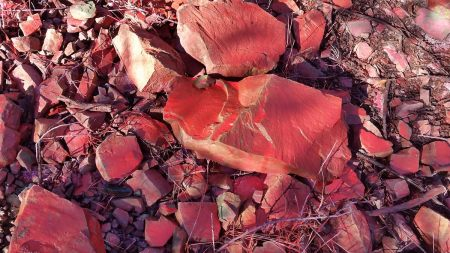 A new meaning of Red Rock — Rocks on Cold Spring covered with flame retardant